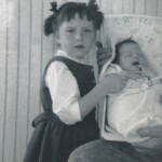 Jane as baby with Robyn