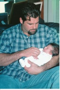 Caminiti holds baby Nicole during